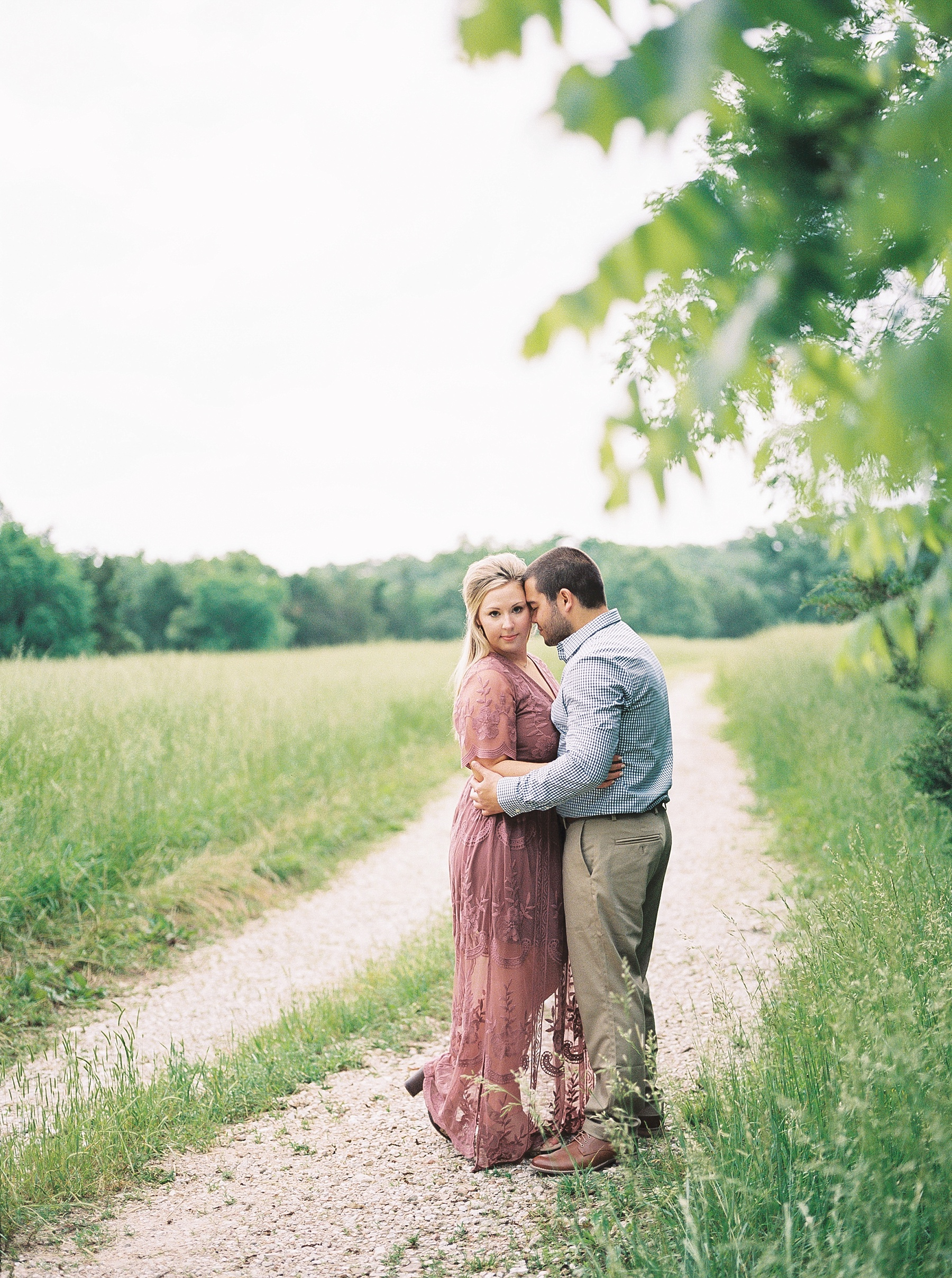 Dusty Rose and Deep Green Rolling Hills Engagement Session by Kelsi Kliethermes Photography Best Missouri and Maui Wedding Photographer_0014.jpg