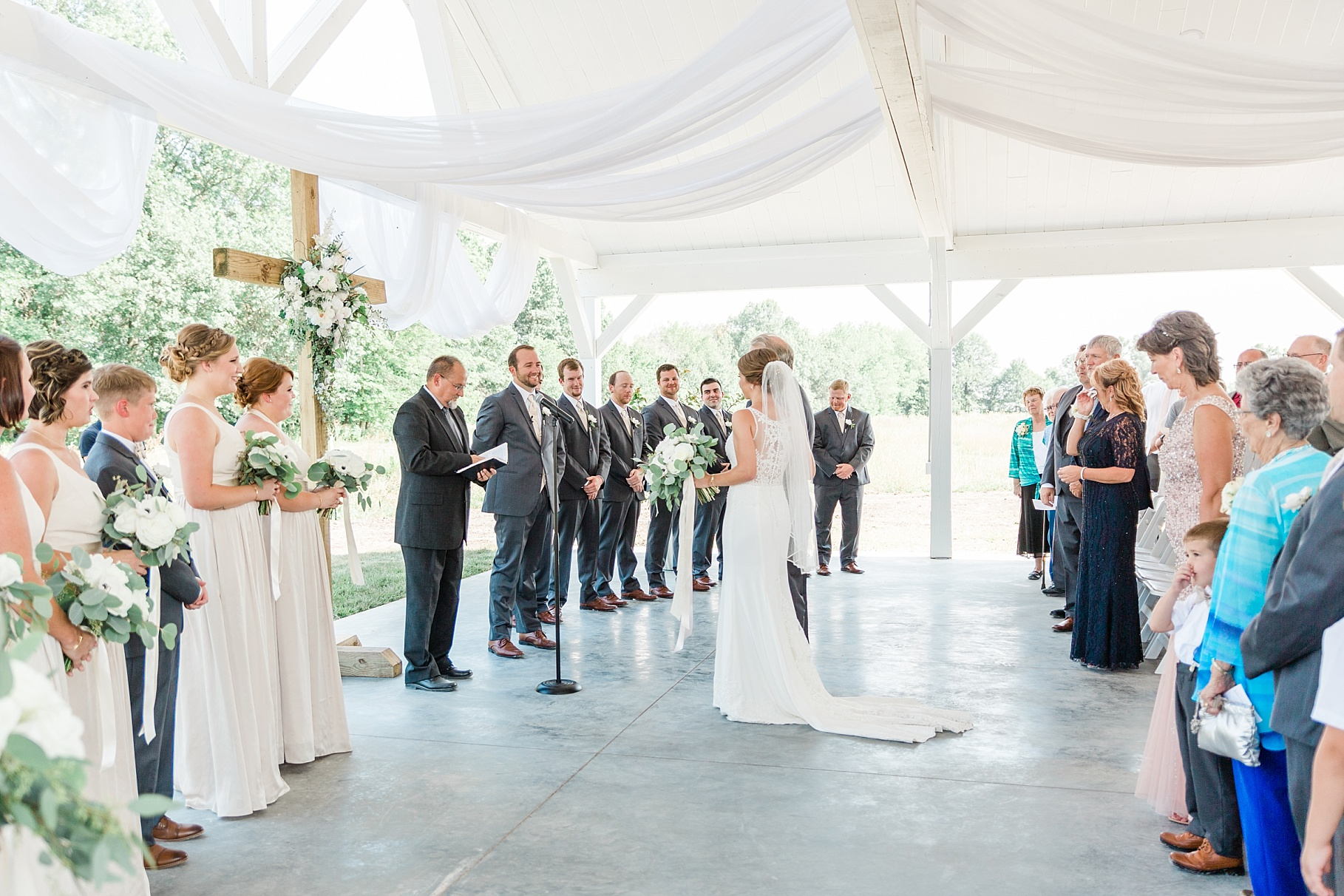 Wedding Ceremony with Confetti Pop at Emerson Fields Venue by Associate Wedding Photographer for Kelsi Kliethermes Photography Best Columbia Missouri and Maui Hawaii Wedding Photographer_0015.jpg