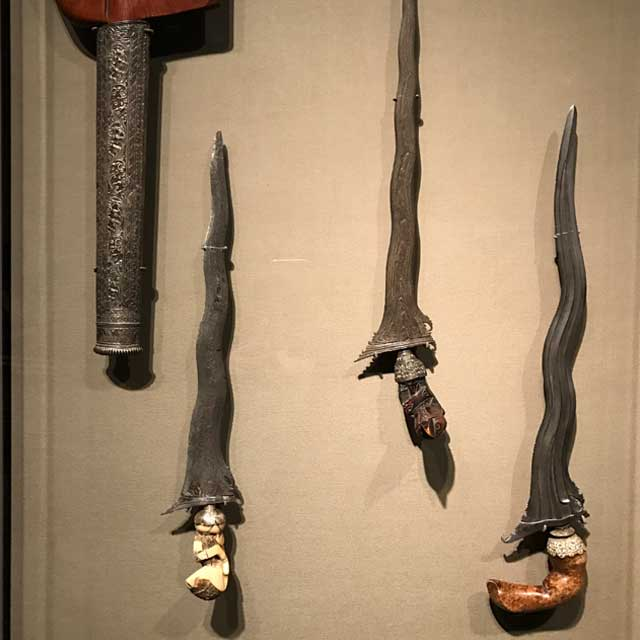 Indonesian daggers, approx. 1850-1950. Two are made from steel, iron, wood, and brass; the other includes whalebone and copper.