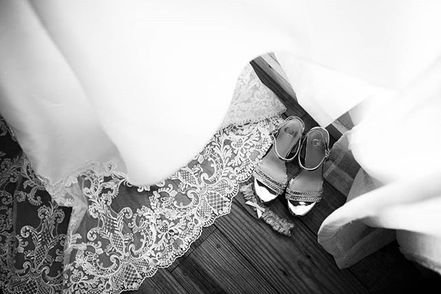 The shoes never get the attention they deserve.  #wedding #weddingphotography #weddingdress #shoes