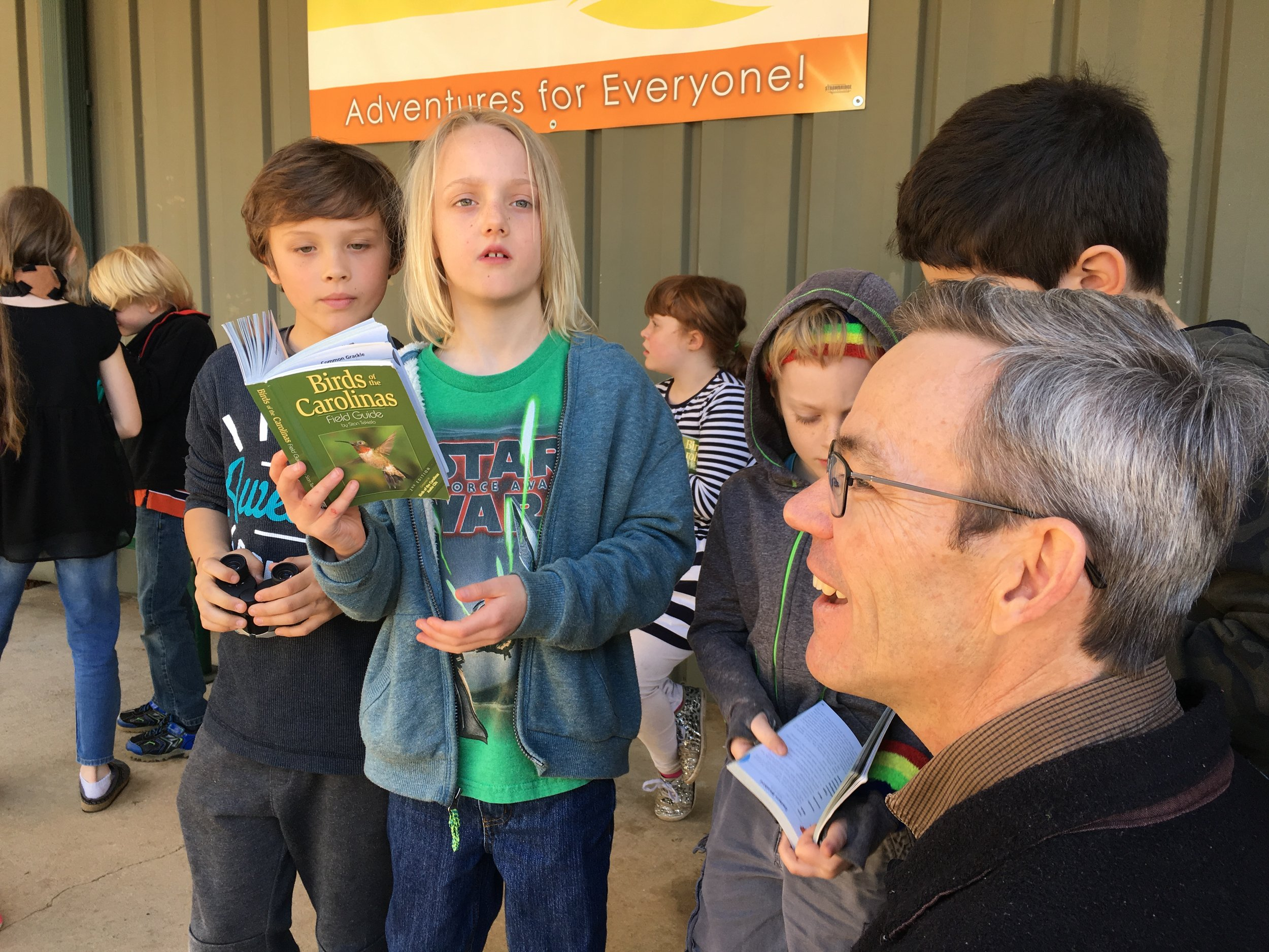 In addition to learning how to use binoculars, students learn to use use ID guides to make educated guesses about the birds they are seeing or hearing in the field.