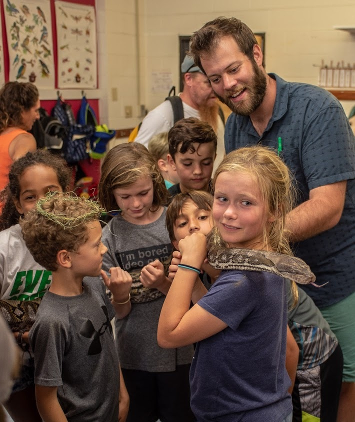 A Visit from Nature Joe - Traveling naturalist, Nature Joe, visited our classroom bringing with him many friends from nature. We held a tarantula. Pet a bearded dragon. Even came face to face with 12 foot long python!