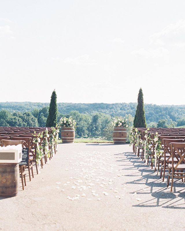 One of my favorite ceremony views! 📷 @hannahforsberg ⠀⠀⠀⠀⠀⠀⠀⠀⠀ #winerywedding #weddingceremony #wedding #weddingseason #weddingday #weddingplanner #atlantaweddingplanner #southernwedding #southerncharm #southern #bride #groom #brideandgroom #bridal #georgiawedding #weddingdetails #weddingdesign #ceremony #ceremonydecor #montaluceweddings #montalucewinery #northgeorgia #northgeorgiawedding #outdoorwedding #summerwedding #weddinginspiration #floraldesign #weddingflowers #weddings