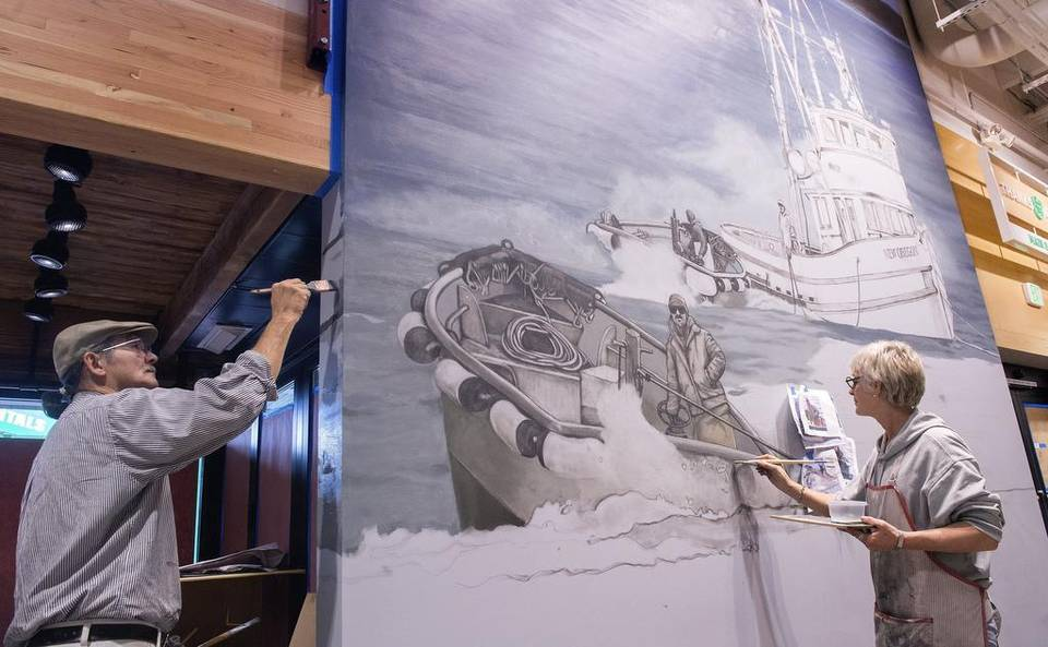 Bob Henry refines the seascape as Lita Dawn adds color to the charcoal skiff.