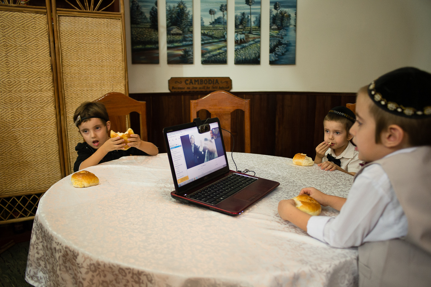 Mushka, Shmulik, and Zalman talk to their grandparents in Israel via Skype on the occasion of Moshe's Bris.