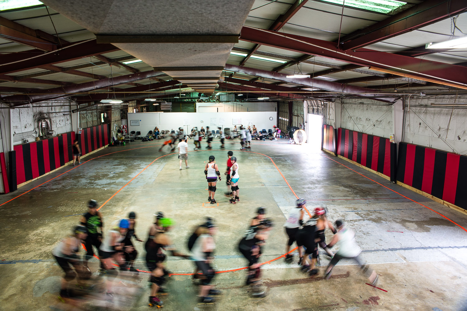 CRG practices in a warehouse next to an auto store on highway 64 in Apex, North Carolina. The rent is high and the player's dues help to pay it.