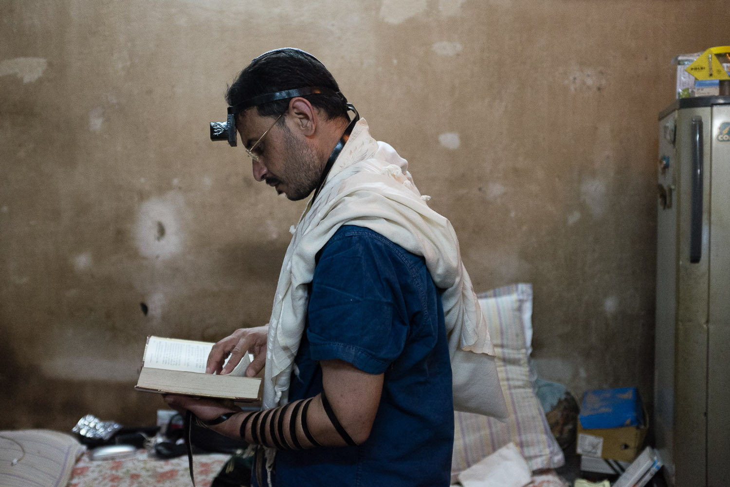"Shalom Israel lives in Calcutta, but he is immigrating to Israel. He tries to pray every day. Sometimes it doesn't happen before noon, ""like it should"", he says, but he makes an effort."