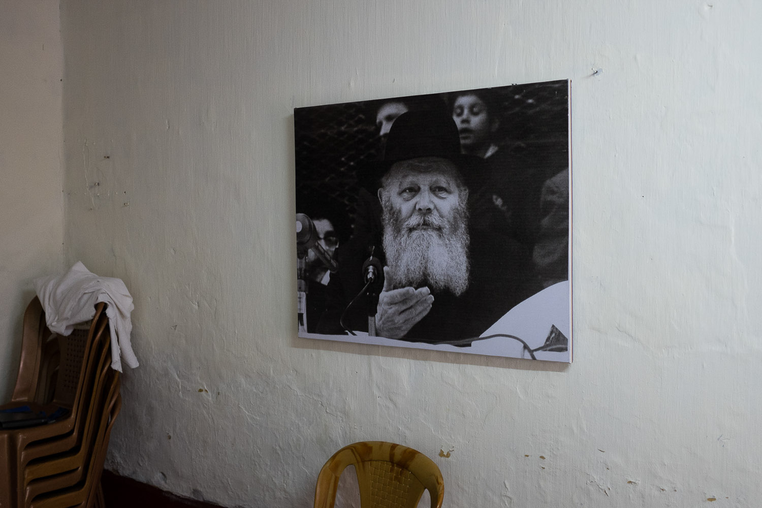 A temporary Chabad house has opened for the High Holidays next door to Sarah's house, to offer services to visitors. They are not sure how many people to expect. Here, the Lubavitch Rebbe (the late leader of the Chabad movement) is pictured.