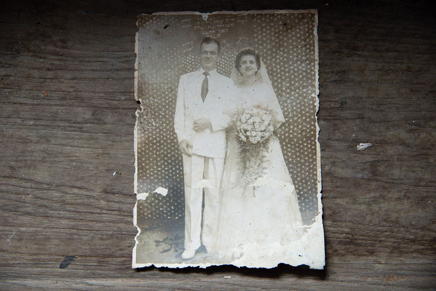 A wedding photograph lies on the windowsill of a Jewish home, vacated in the last decade as its owners died or left for Israel. The ground floor of the house now serves as the temporary Chabad house.