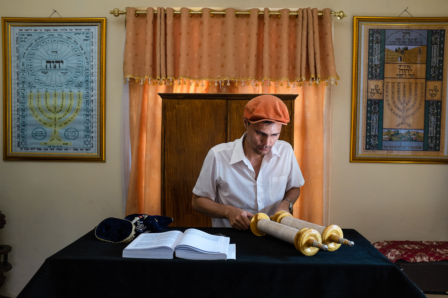 Vicky Ratumbanua (Avshalom) opens his Torah scroll in his home synagogue in Manado, North Sulawesi, Indonesia.