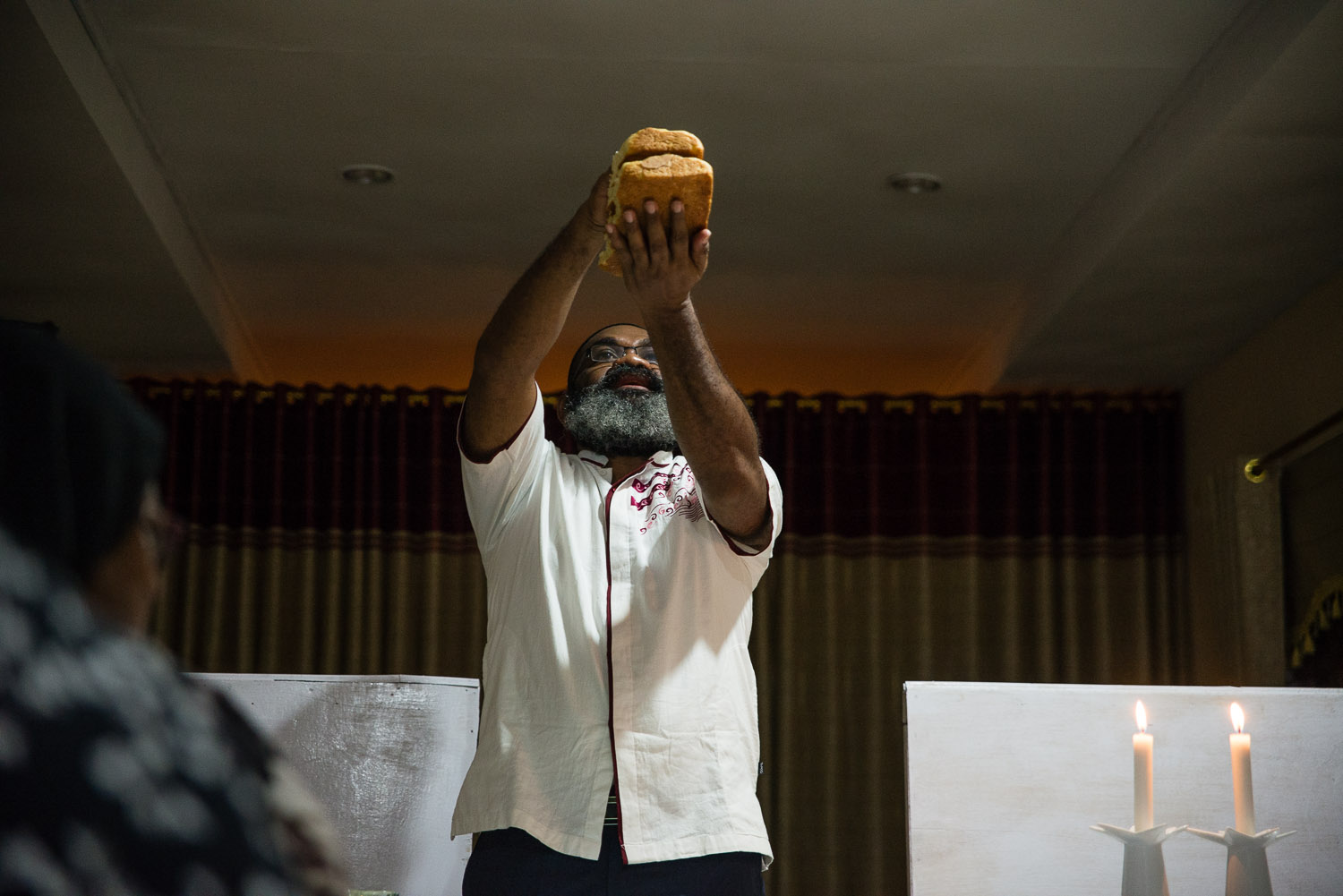 Harun holds the Challah to be blessed on Friday night Shabbat services in his home synagogue. He and Diane are not only leaders of the community, but also teachers, bringing prayer and song into the lives of the community members.