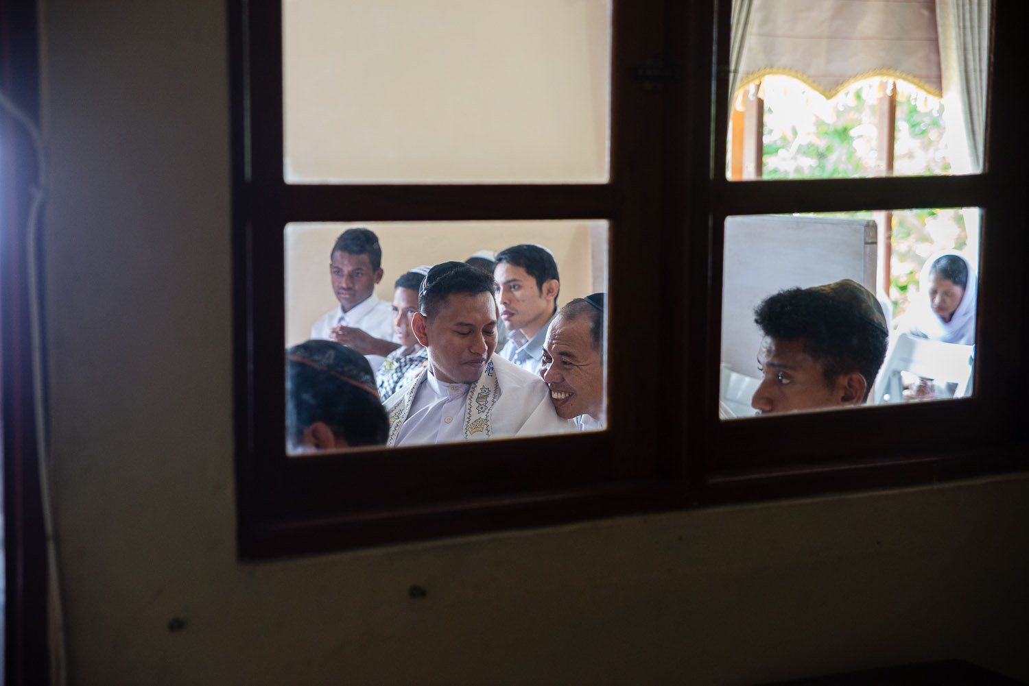 Men greet each other after Saturday morning services finish in Jayapura. The Jews in Papua have African, Peruvian, and Indian roots