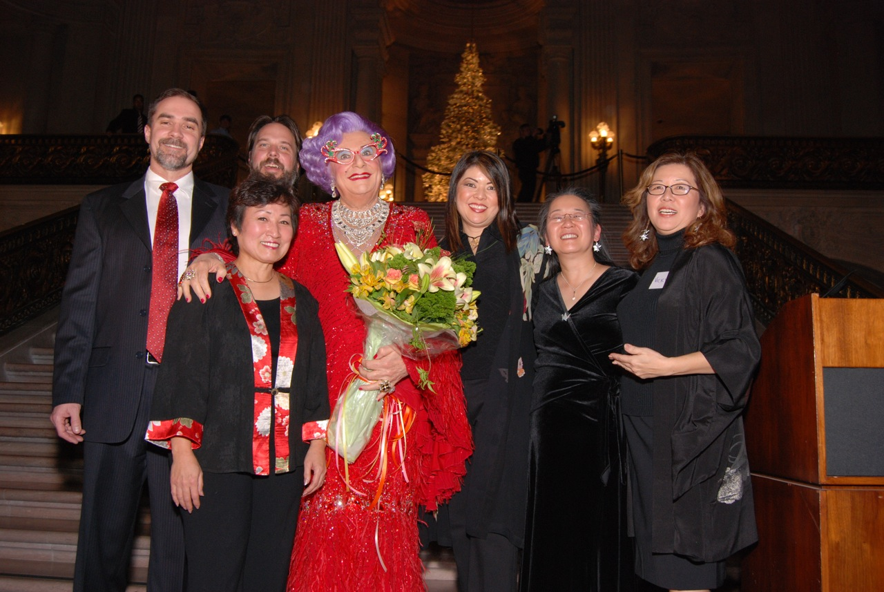 Dame Edna Everage with the tree's creators after she light the 2008 RWF World Tree of hope