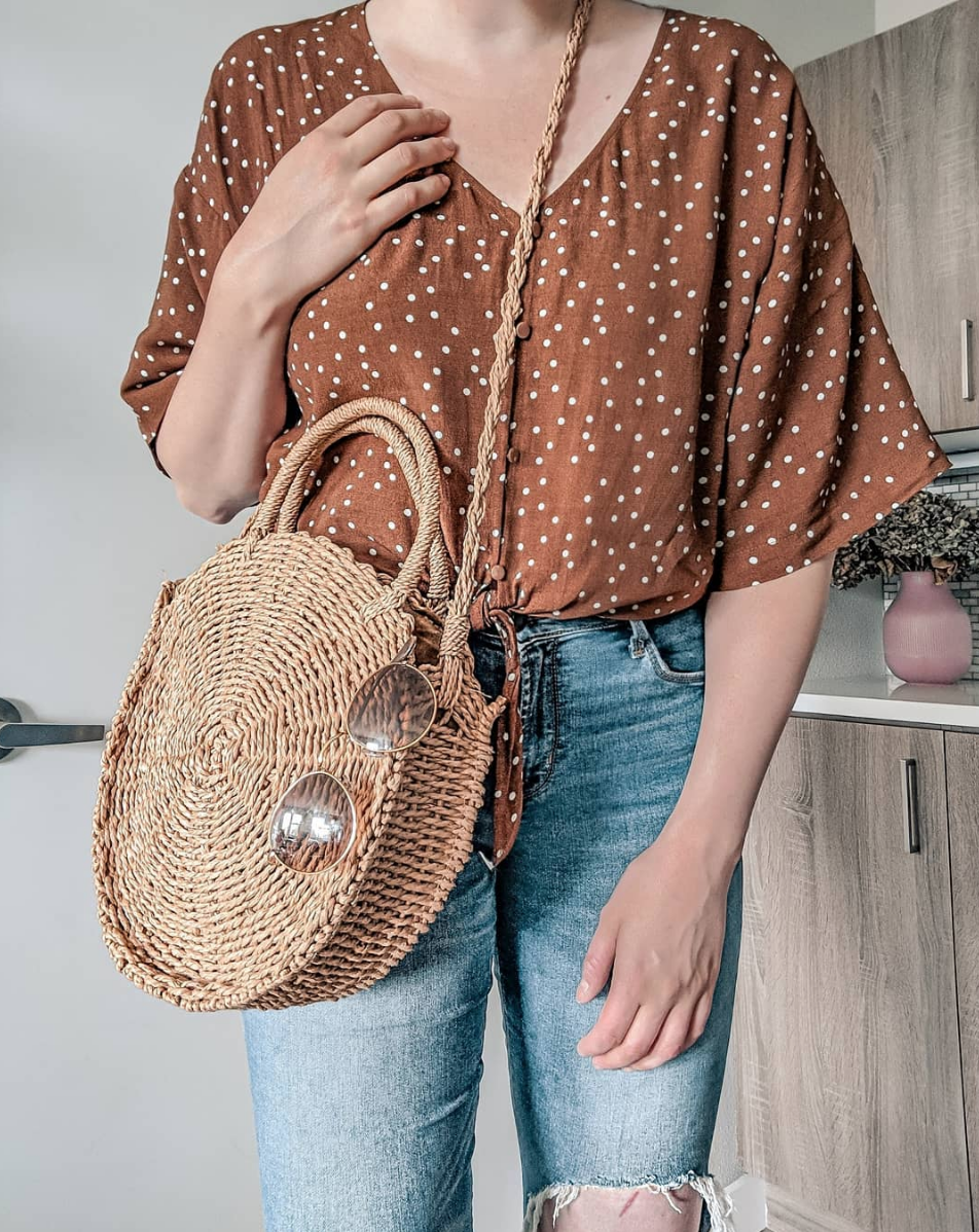 Polka Dots - The best fall transitional top! Not only are polka dots always on trend, this color is so unique and I just love it so much. Had to pair it with my favorite woven bag of the summer (under $20)!TOP // BAG // SUNNIES // DENIM (similar) //