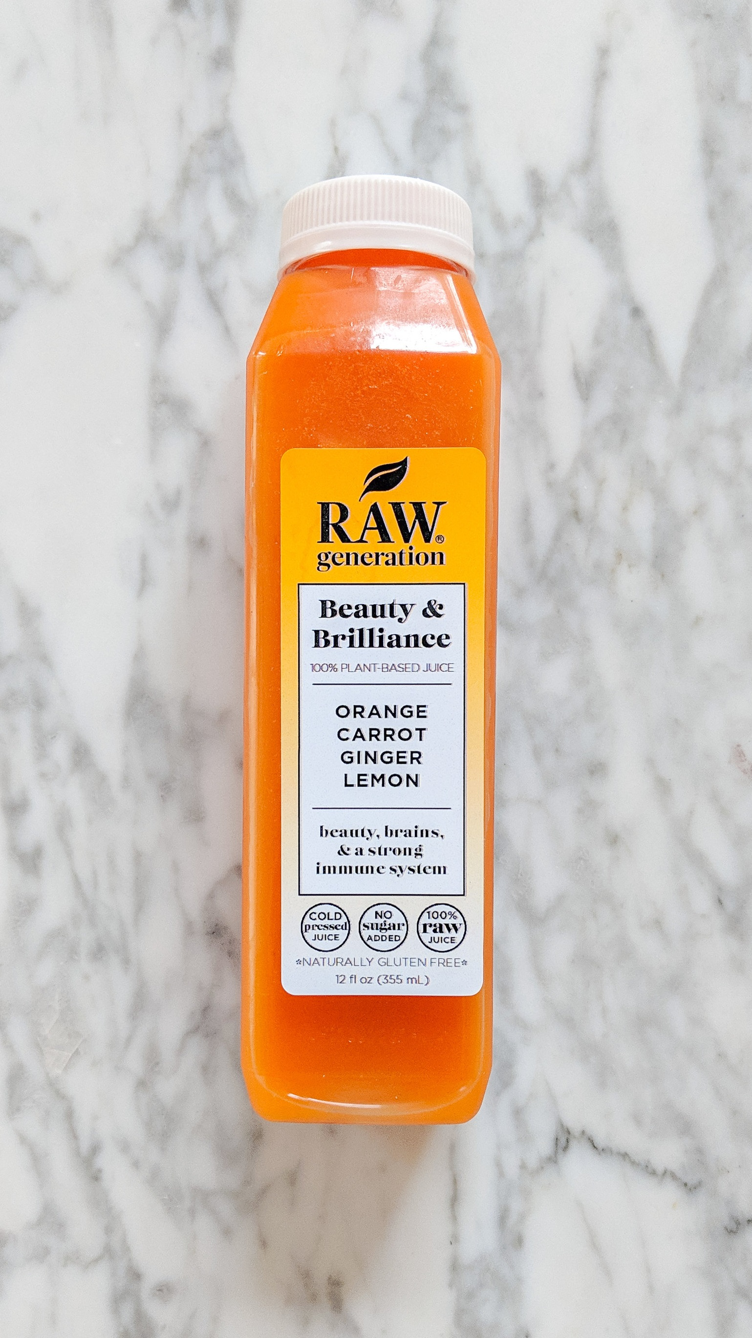"""Beauty & Brilliance"" - INGREDIENTS: carrot, orange, lemon, ginger, filtered water.WHAT IT DOES: This juice is for ""beauty, brains, and a strong immune system."" This juice I drank around dinner time and was one of the more filling and satisfying juices. I love anything with ginger and lemon too, it was delicious!"