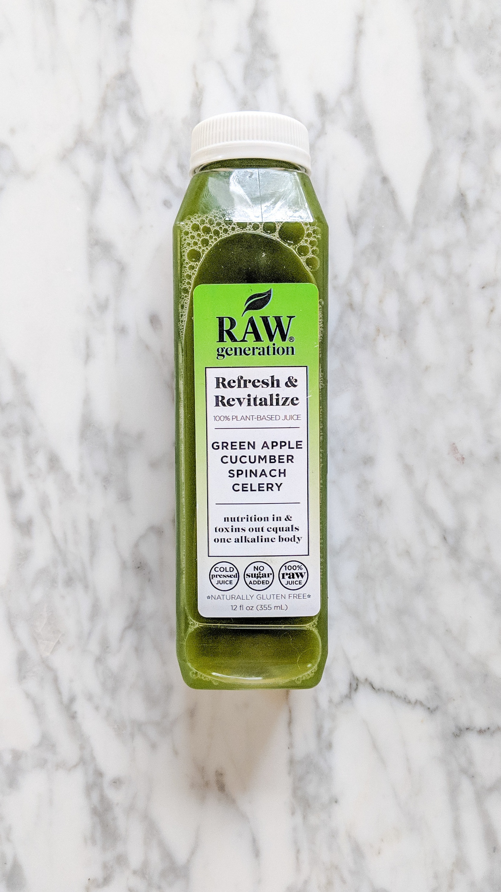 """Refresh & Revitalize"" - INGREDIENTS: green apple, cucumber, spinach, celery, and filtered water.WHAT IT DOES: This juice is for putting ""nutrition in & toxins out."" Most days I drank this one around lunch time!"