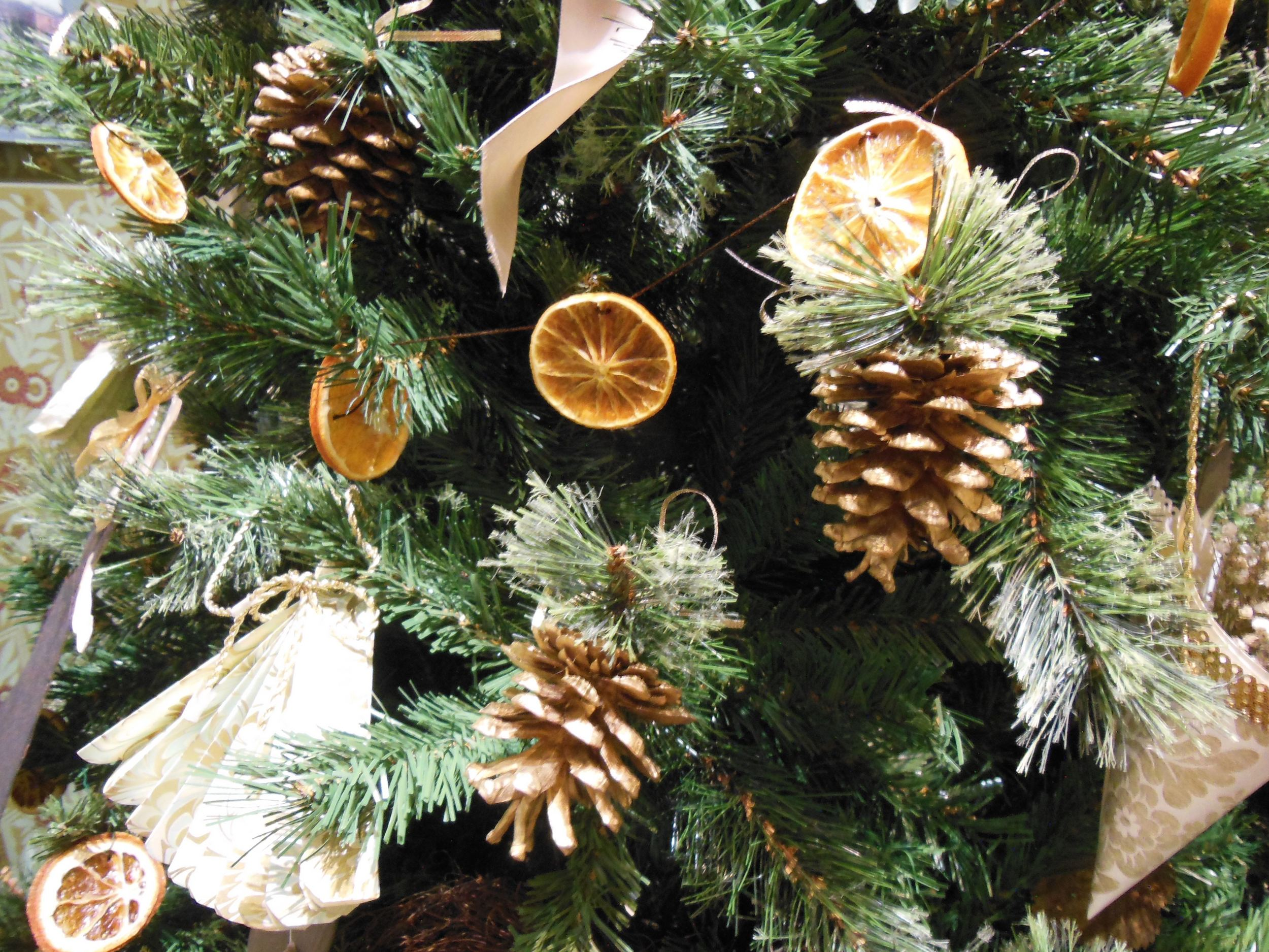 Dried orange slices strung as a garland through a Christmas tree.
