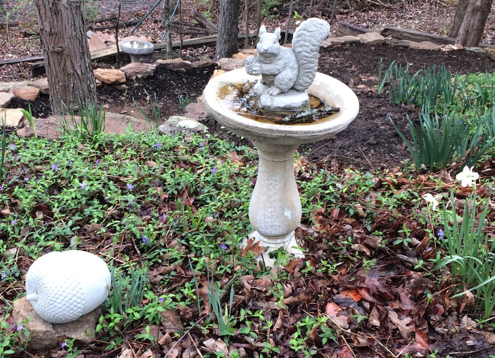 Garden ornaments add interest to bird baths in my garden.