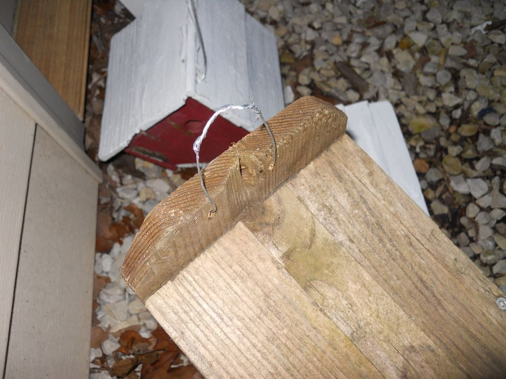 Rehabilitate well-used bird houses by adding new holes and wire to be able to rehang them.