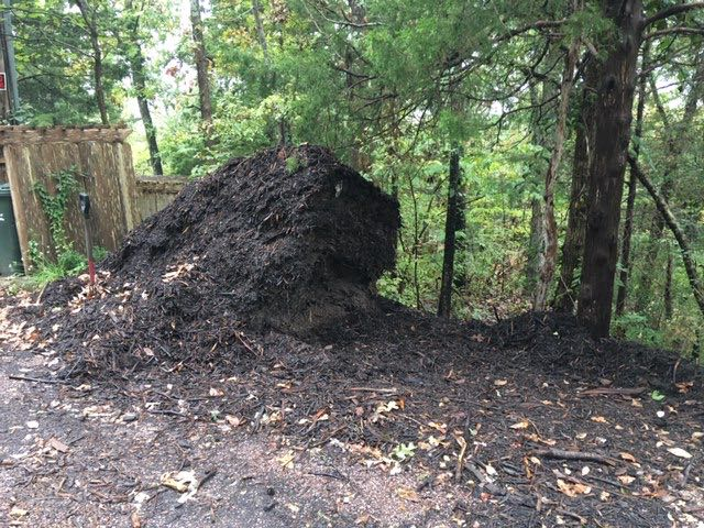My leftover mulch pile, almost moved into the garden. (Photo by Charlotte Ekker Wiggins)