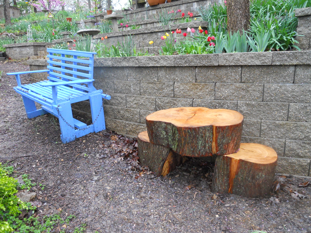 My new tree stumps bench replacing the larger blue bench. (Photo by Charlotte Ekker Wiggins)