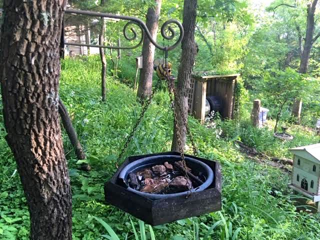 These hanging bird baths can easily be repurposed on tree stumps. (Photo by Charlotte Ekker Wiggins)