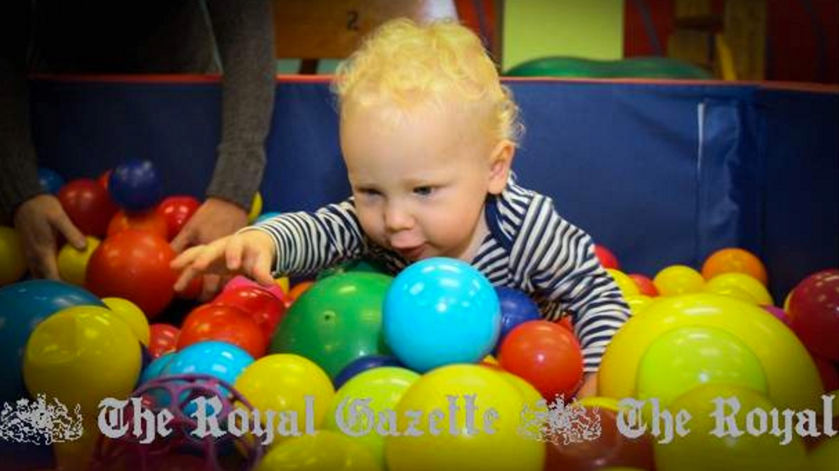 Having a ball: Archie Hollis, 15 months, explores the bright ball pen at BSMART's morning playgroup yesterday. The twice-weekly sessions aim to improve cognitive development. (Photographs by David Skinner)   http://www.royalgazette.com/article/20151119/NEWS/151119654