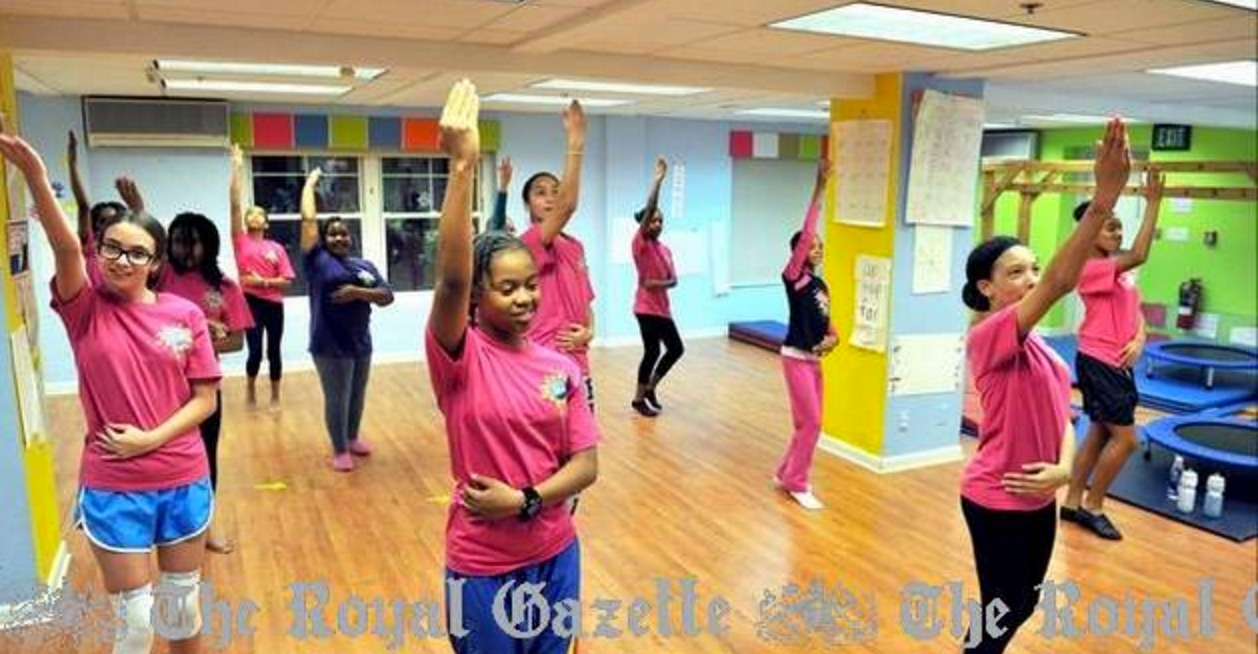 Students in the Bsmart Bollywood Club Performance Team practice on a Friday night. (Photo by Mark Tatem)   Click image to view story   http://www.royalgazette.com/article/20130129/ISLAND01/701299987