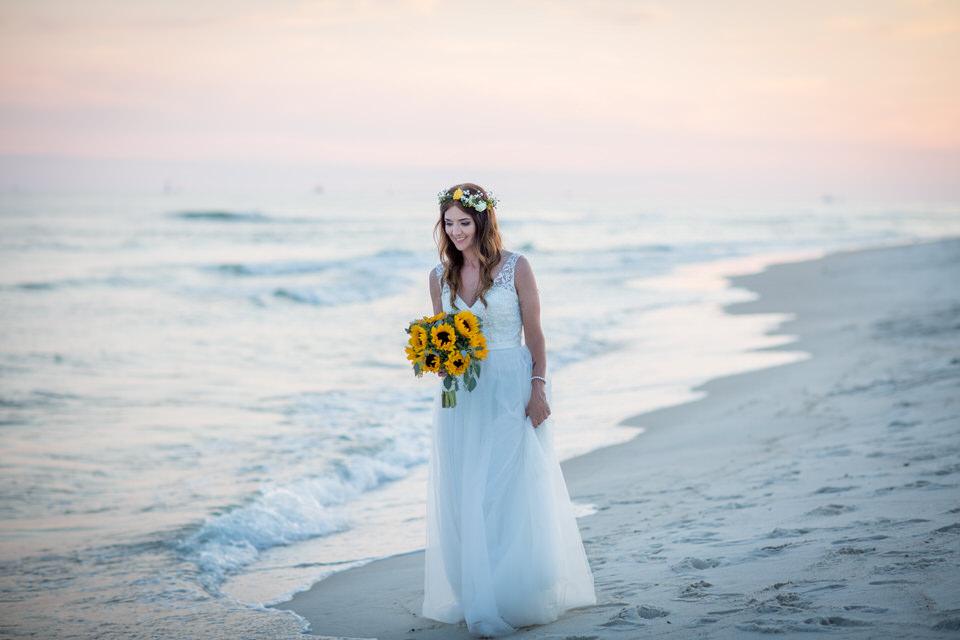 bride ocean wedding flowers
