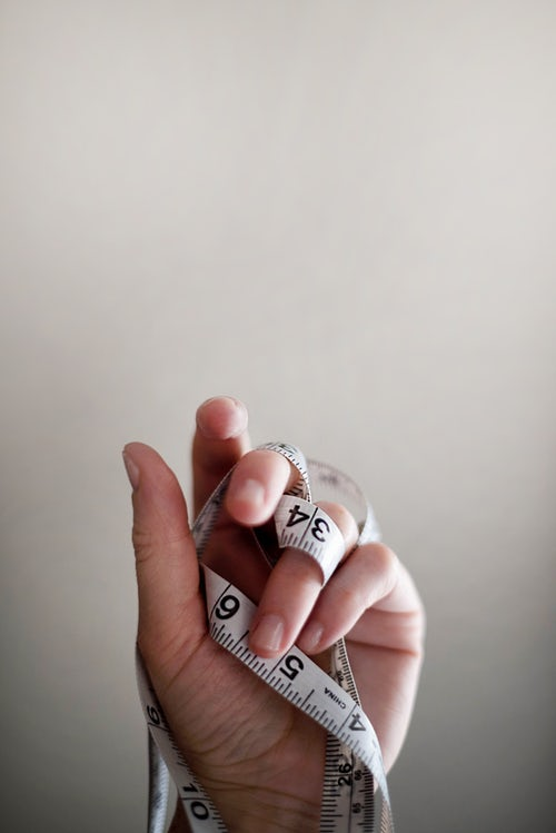 hand and tape measure.jpg