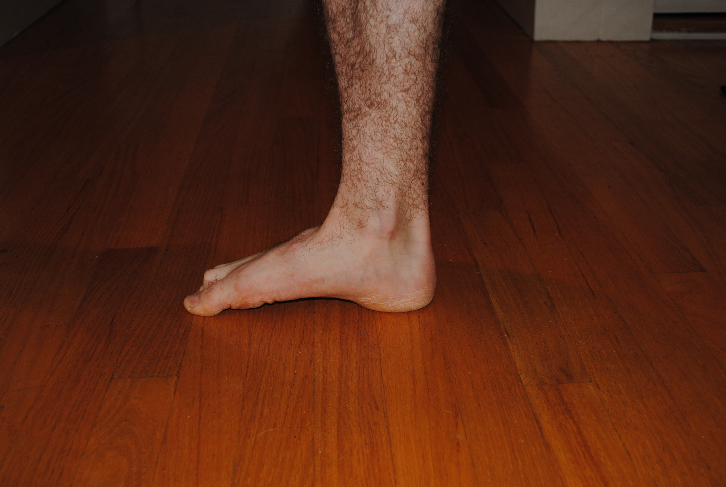 Press down with your toes while raising the arch of your foot.