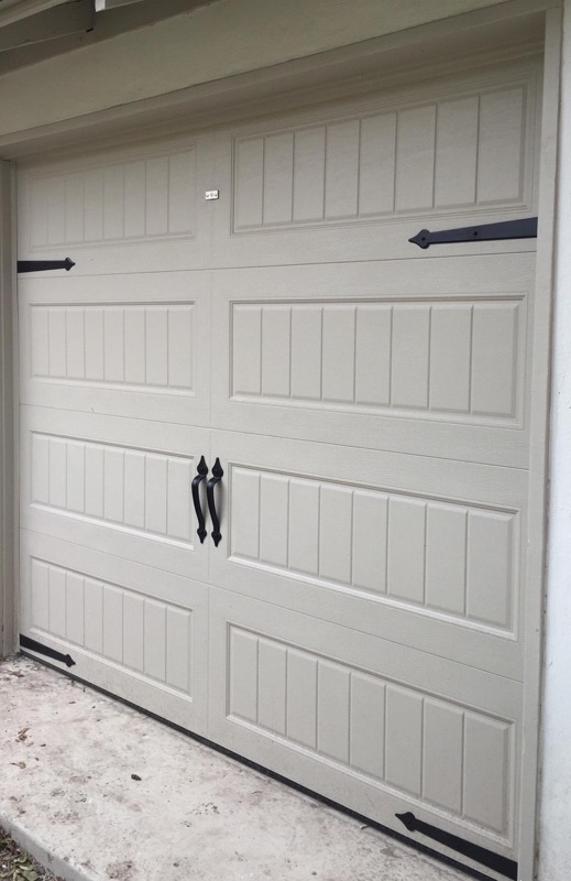Long panel bead board garage door with magnetic hardware