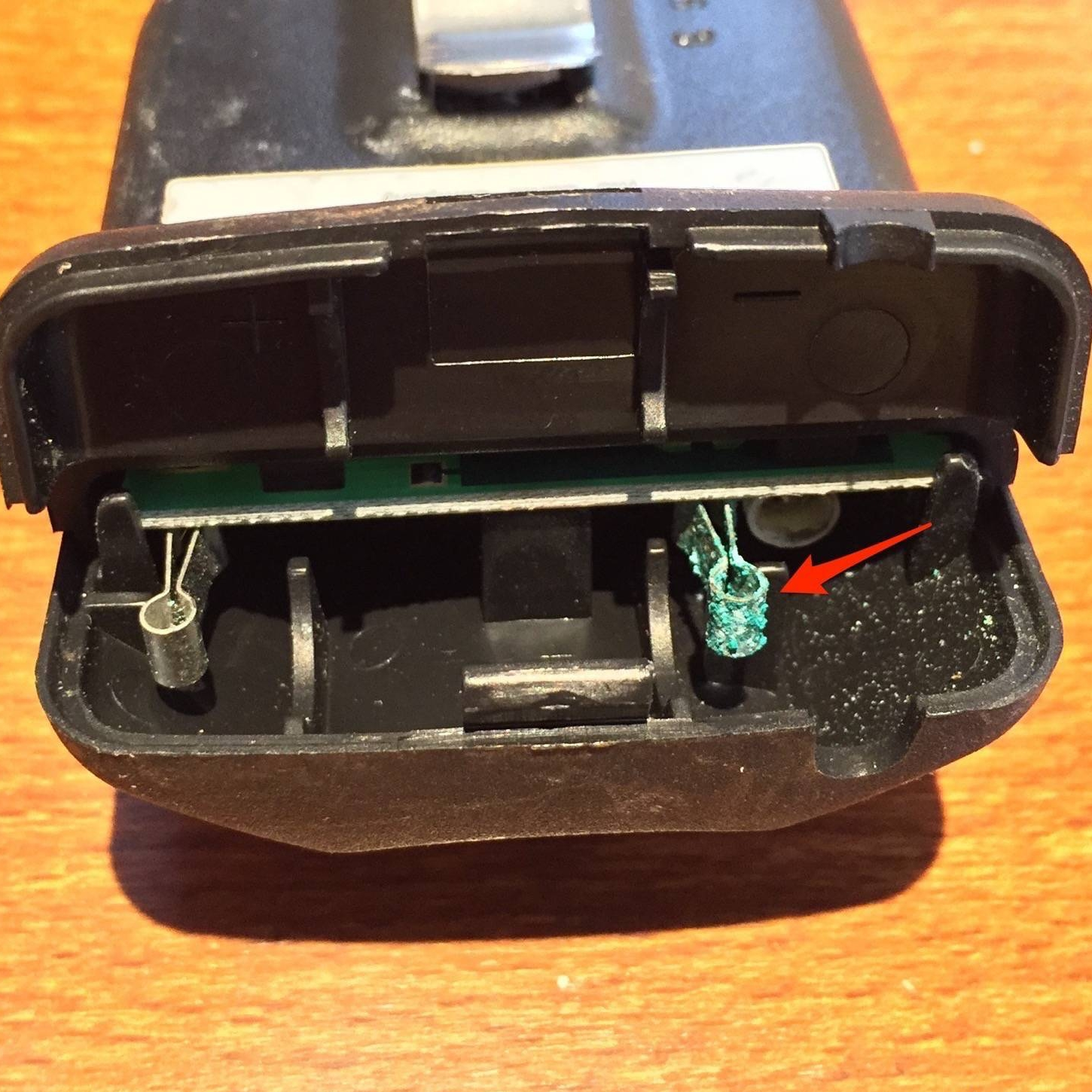 Corrosion on Genie remote battery contacts