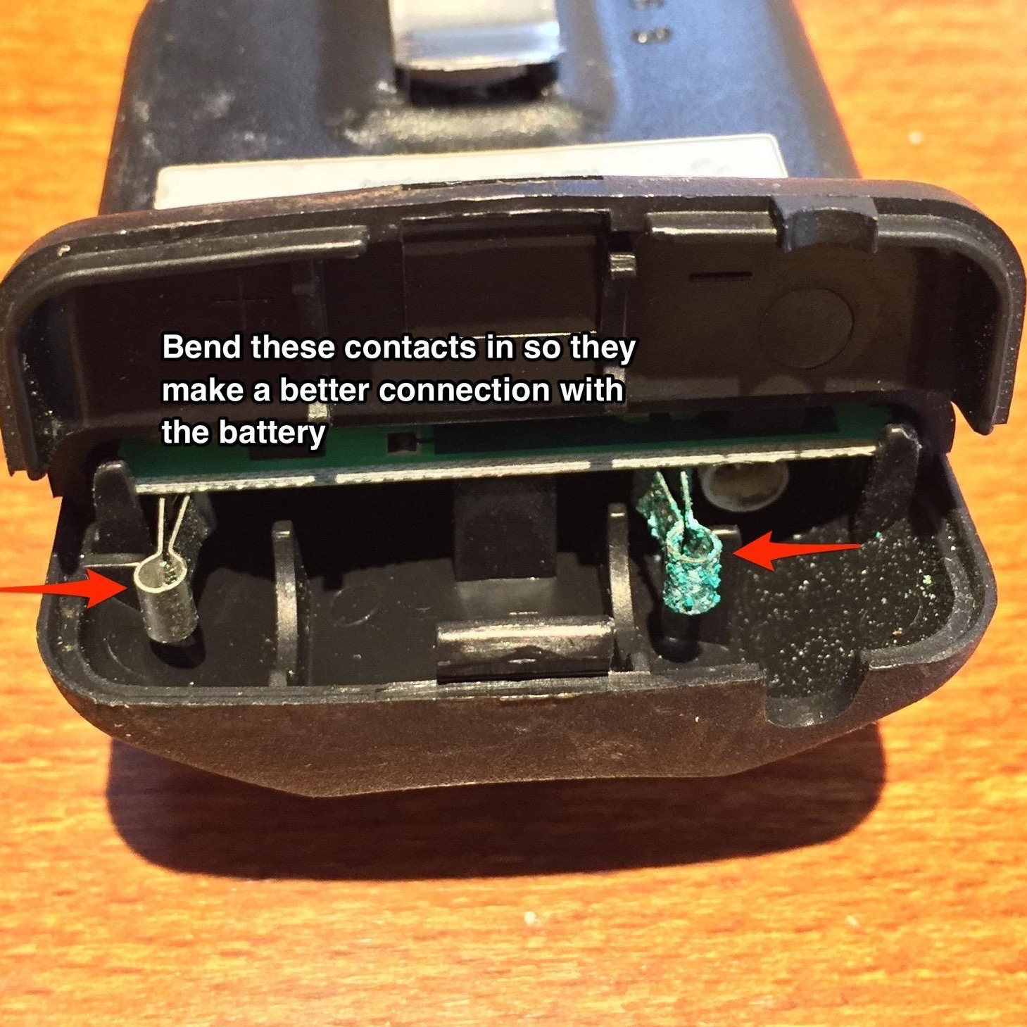 Bend these contacts in so they make a better connection with the battery