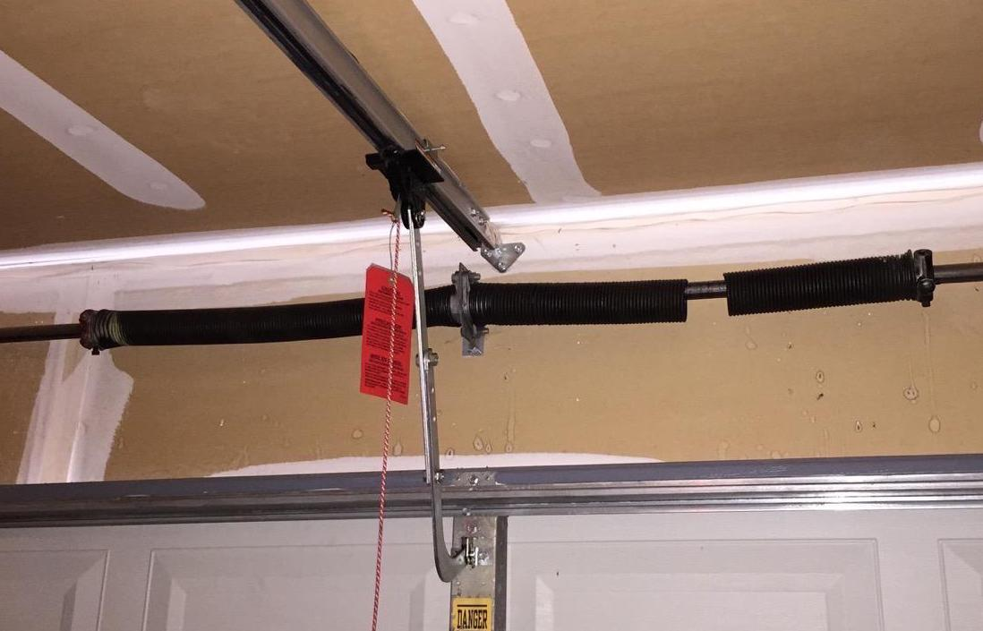 Broken garage door torsion spring
