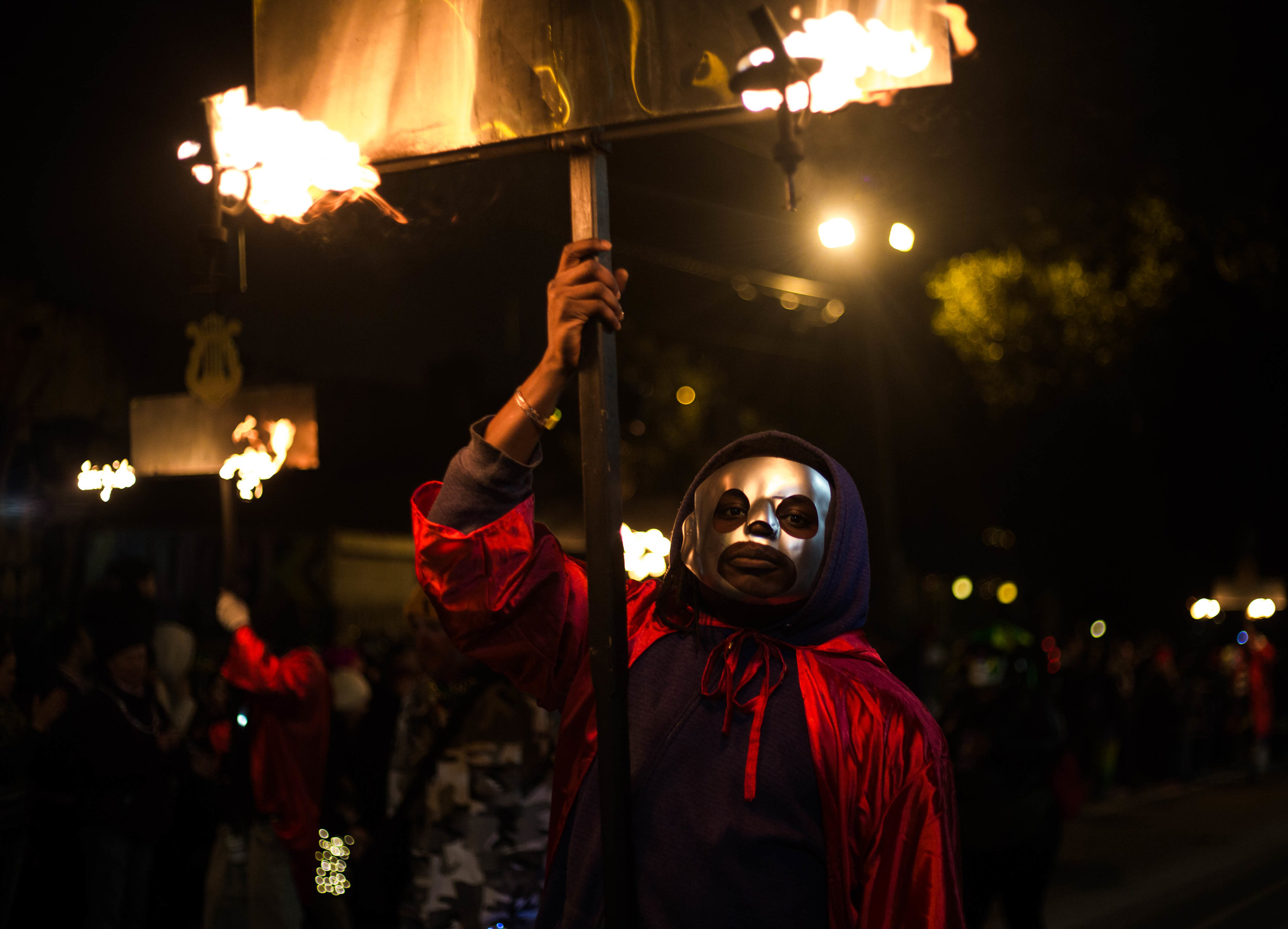 The Flambeaux, the original Mardi Gras lights, were needed for revelers to see the Carnival parades at night. They carried wooden rudimentary torches and lit pine tar rags to light the way.