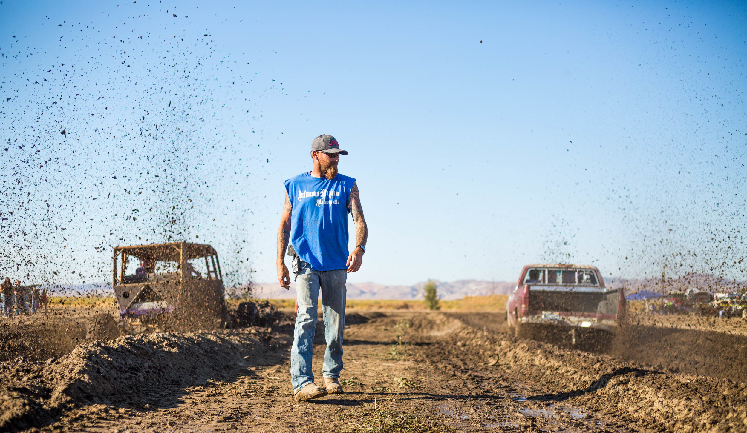 A Walker River Reservation local directs the annual mud drag races which attracts crowds from all over rural Nevada in early August.