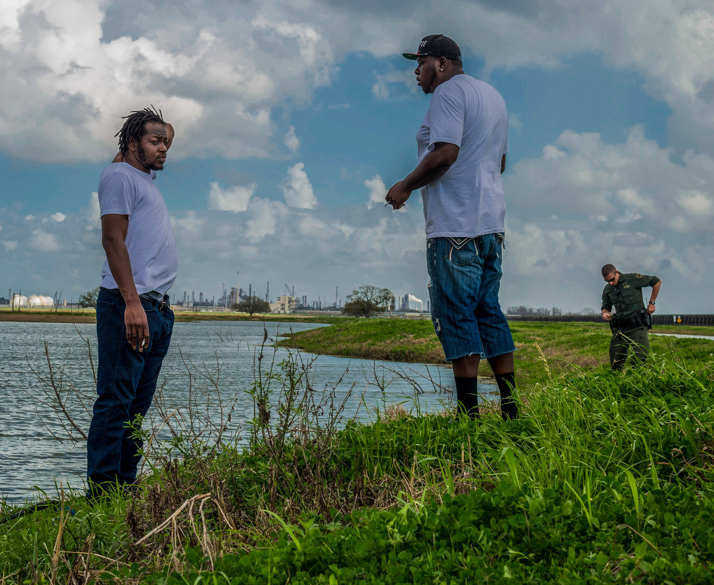 Robert and Chris were ticketed for not having their fishing license on them for the third time this year. The little fishing hole was rimmed with dead turtles, a causation of oil factory leaching.