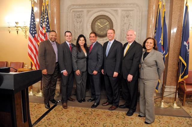 From left to right, the IDC members minus Jose Peralta: Jesse Hamilton, David Carlucci, Diane Savino, Jeff Klein, David Valesky, Tony Avella and Marisol Alcantara. (via Facebook)