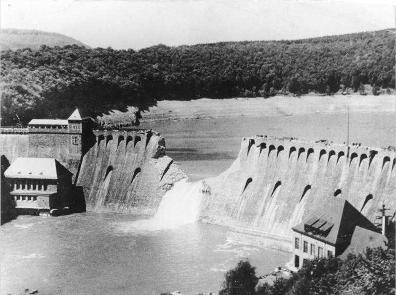 The Eder Dam 17 May 1943 draining into the valley below (courtesy of the MoD)