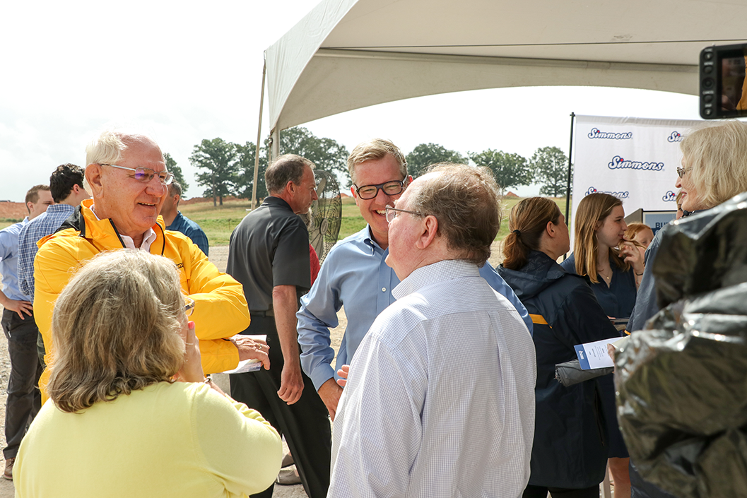Mark Simmons, Chairman, Simmons Foods and Todd Simmons, CEO and Vice Chairman, visit with guests at the Site Dedication.