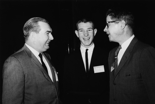 Photo: Mark Simmons, Chairman of Simmons Foods (center) with his father Bill Simmons (left) and U.S. Secretary of Agriculture Orville Freeman at the Institute of American Poultry Industries Fact Finding Conference in Kansas City in 1963.