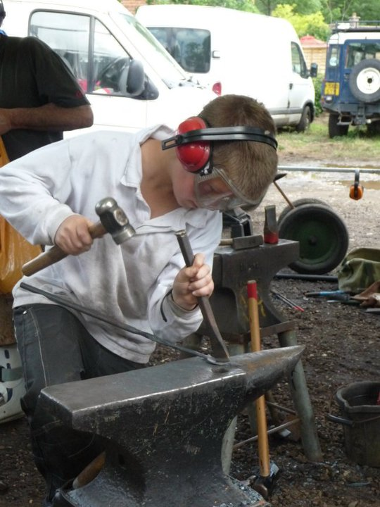 Me aged 11 or 12. Hammering away at a blacksmithing event! PPE game was strong!