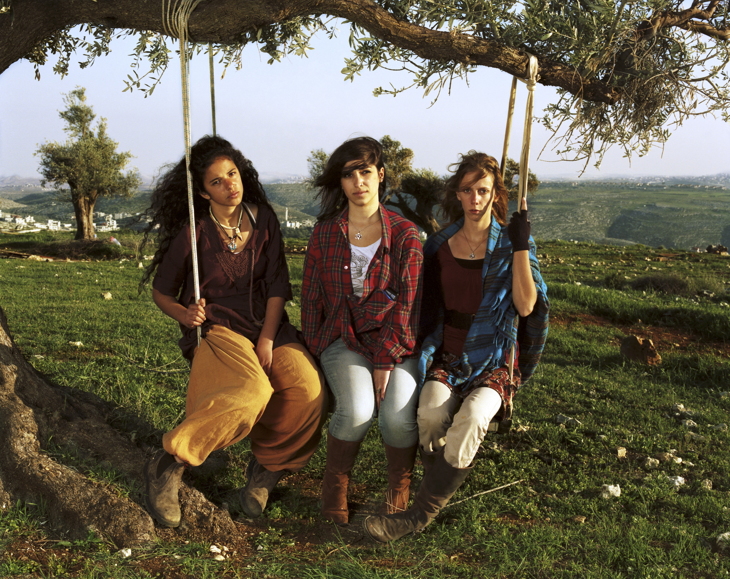Bat El, Moriya and Chaya, 2011   For Bat El, Moriya and Chaya, hiking up to the hilltop outpost in Migron is a political act, but it also has the feeling of a simple teenage hangout—someplace far away from adults. Their way of protest is to build.