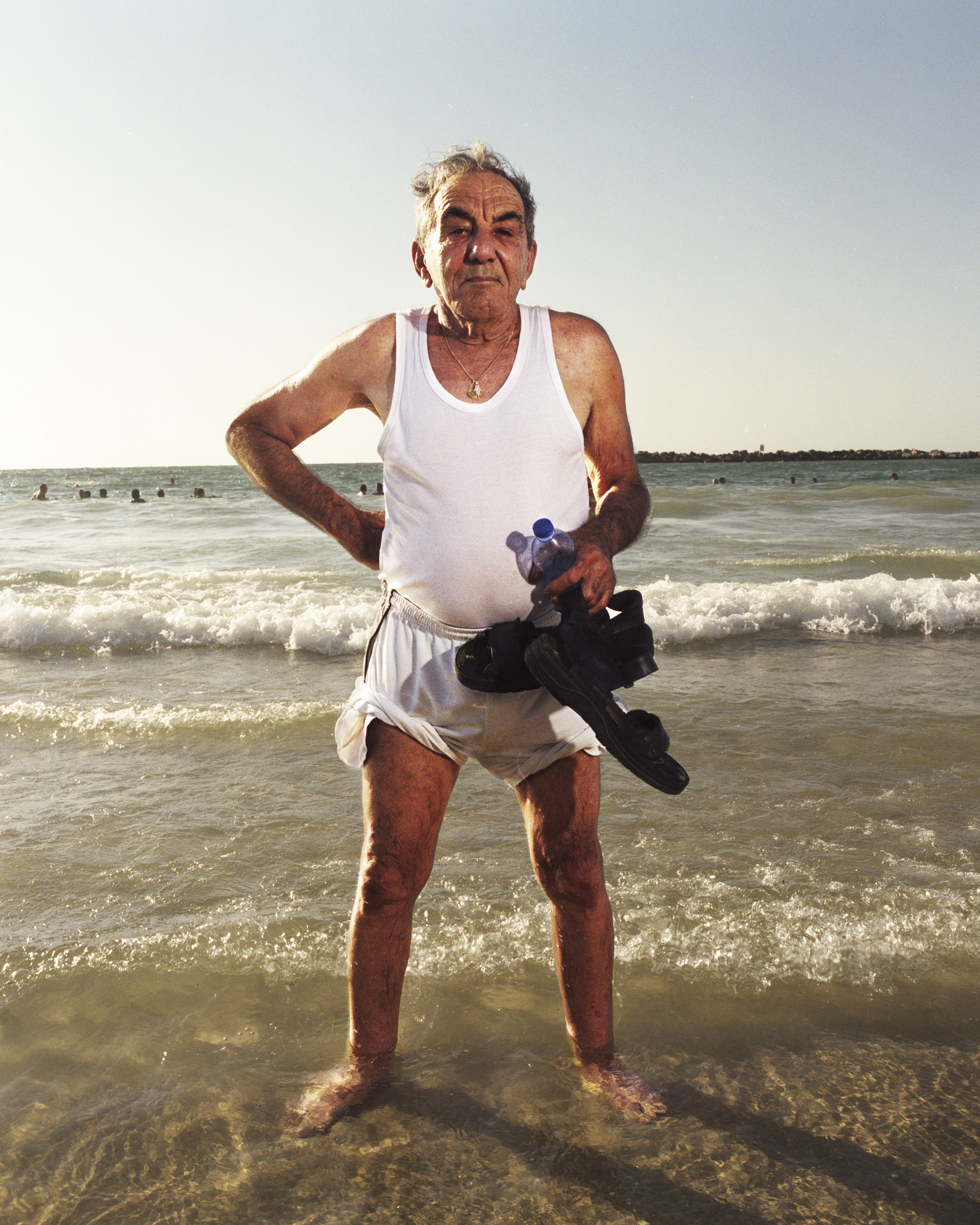 Yossi, 2011   Yossi, 78, likes to come to the beach twice a day, at sunrise and sunset.
