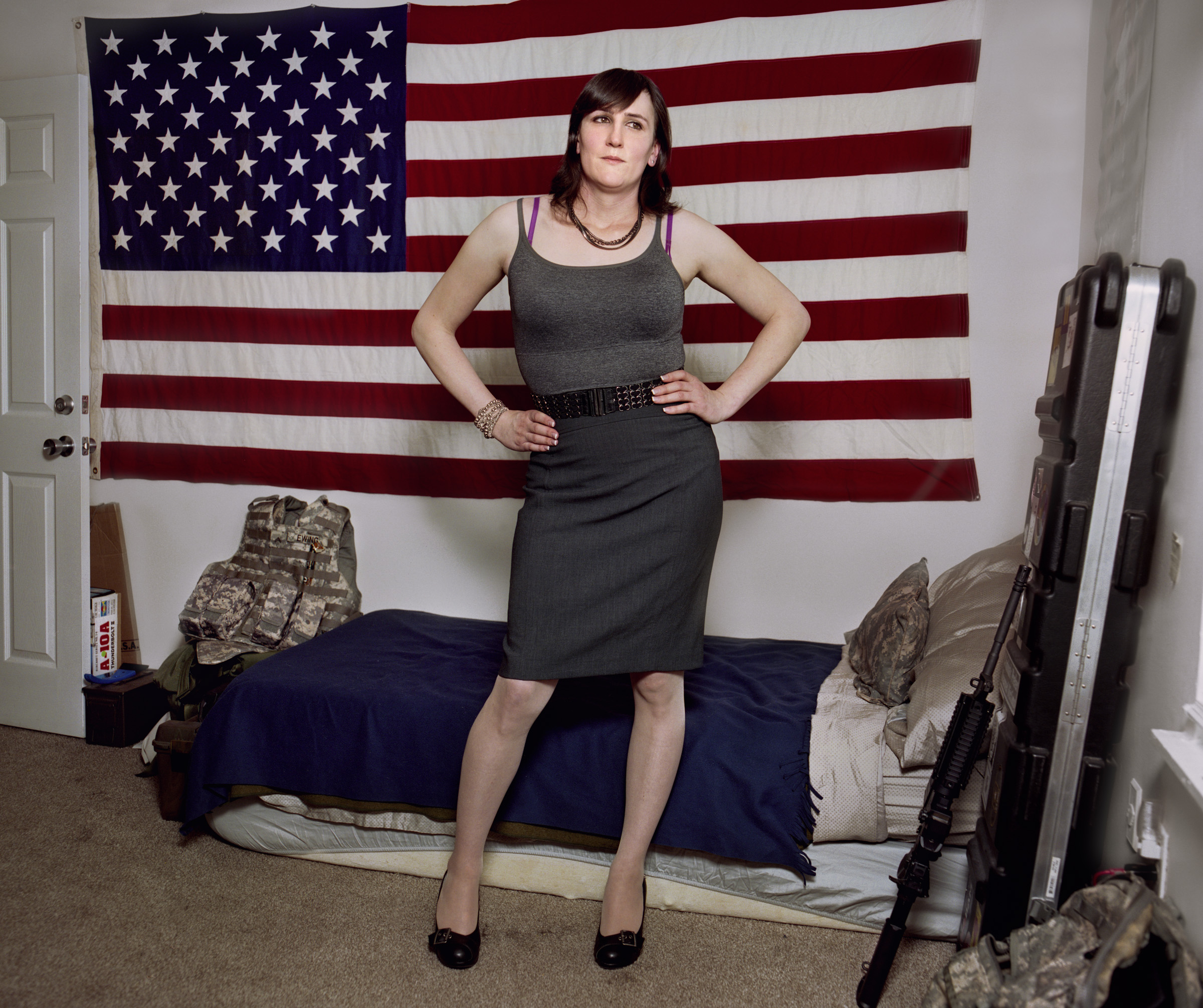 "Jamie Ewing, 2014   Jamie Ewing served in the US military for five years--until November 2013, when she was discharged for being Transgender. (The military does not allow trans people to serve openly.) Ewing is now working as a defense contractor, getting paid much more for similar work. ""I would trade my current job in a heartbeat for the Army if it meant I could wear a uniform again,"" she says. ""It's all about that sense of serving my country."" In her current role, she interacts with many of the same commanders she worked with while in uniform. ""They know me. They know my work ethic and skill sets, and they have no issues,"" the 28-year-old says. ""I'm still the same person."""
