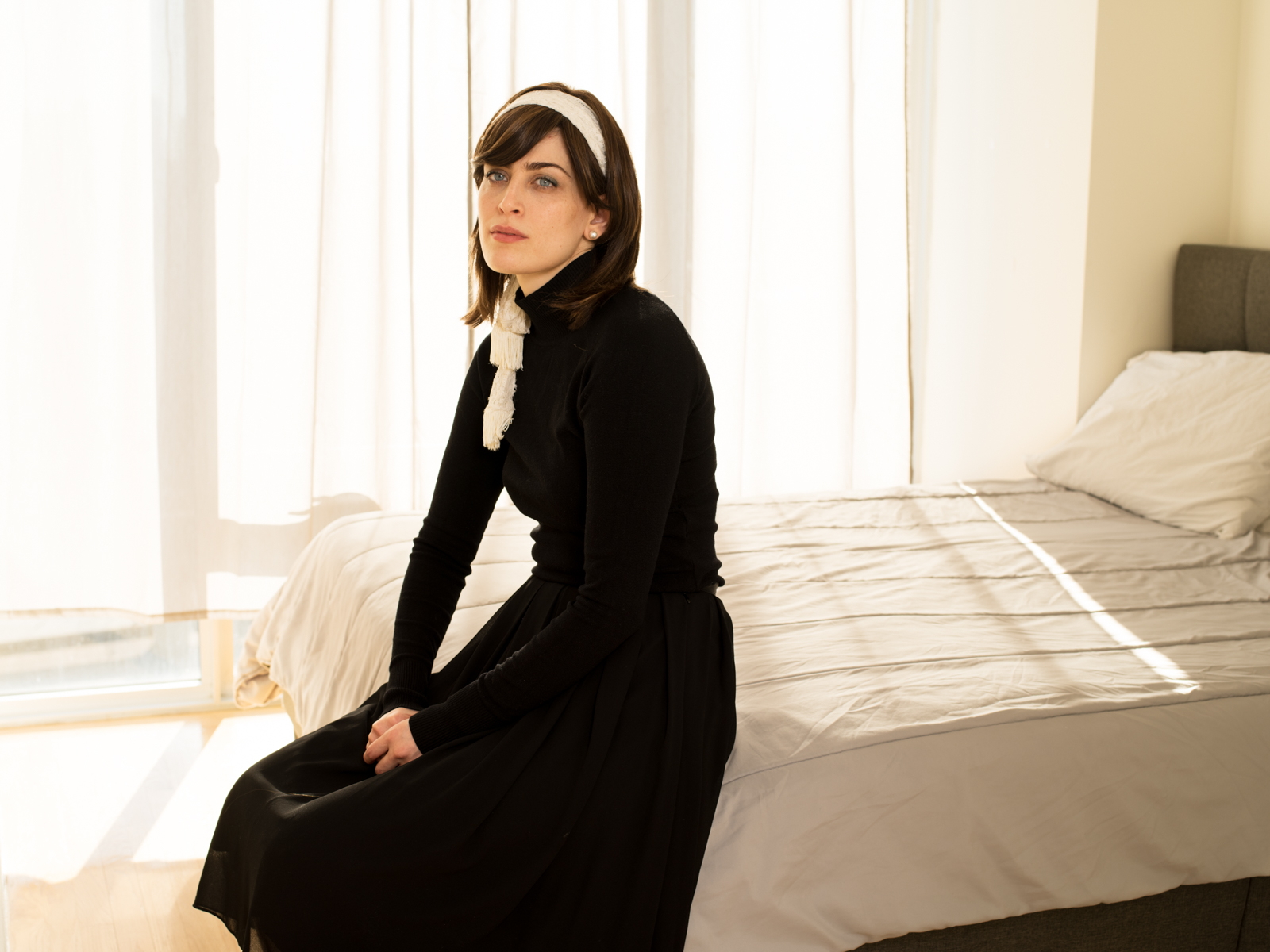 """Melissa Weisz   This is Melissa Weisz in her Williamsburg apartment wearing traditional Hasidic clothing. She dresses like this when she goes to visit her family who are still deeply religious. She left the Satmar community in Borough Park 10 years ago when she was 24 years old. She said leaving her community, especially her husband, parents, six sisters, and two brothers, was the most terrifying and liberating moment in her life. """"I wish I could've stayed. After trying for years, I was finally ready to lose and risk everything to live the life that felt right to me. But I had so much guilt and shame for leaving, hurting the people I love most. It was a painful process. My family is so important to me and I didn't want to hurt my husband. He's a good person. When I first left, I had a roommate who also left the religious community. She struggled a lot and took her own life. It was scary. I think my family worried that would happen to me if I felt alone and not supported. They have made a lot of effort to accept my choices and we've worked hard on our relationship. I don't feel alone, but I often feel like a foreigner in my own city. That's why most of my friends are European. Maybe we connect as outsiders living in this big unfamiliar world together""""."""