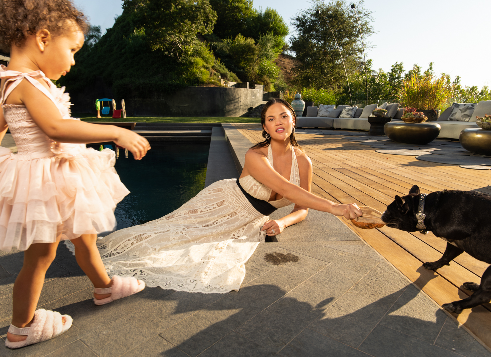 Chrissy Teigen with her daughter Luna, and dog Penny / Vogue Magazine