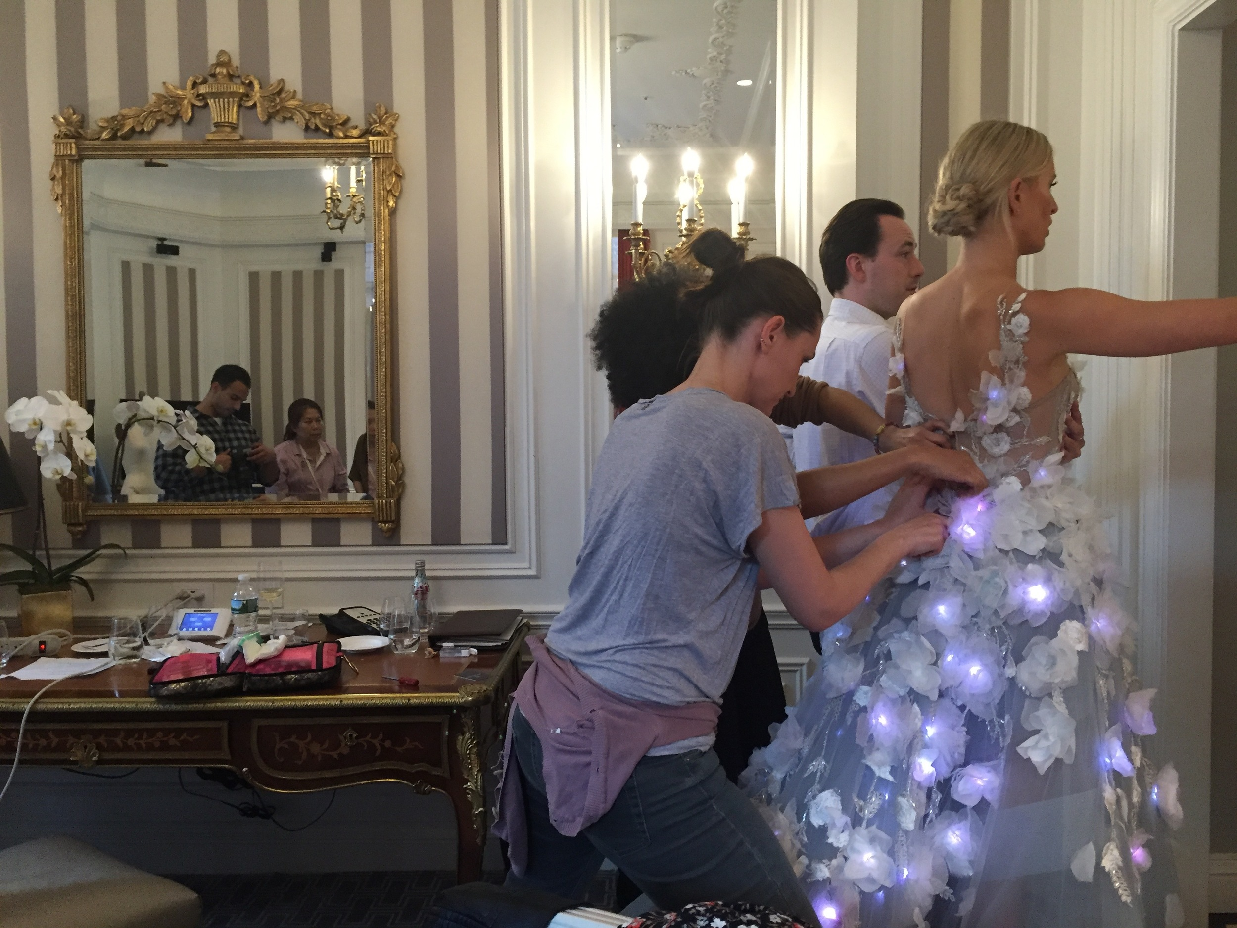 Karolina Kurkova rushes out of the hotel suite while we upload new code over the air