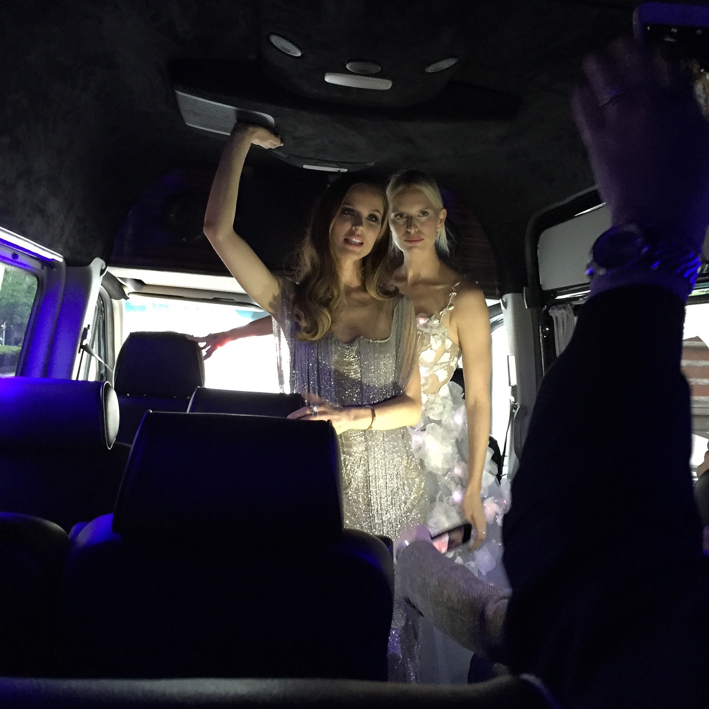 Georgina Chapman and Karolina Kurkova in the van on the way to the gala while we continue to upload new code to the dress
